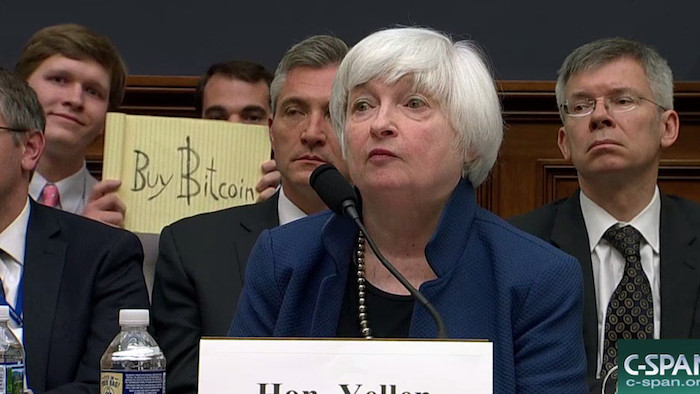 Bitcoin sign guy holding a buy bitcoin sign during janet yellen federal reserve hearing